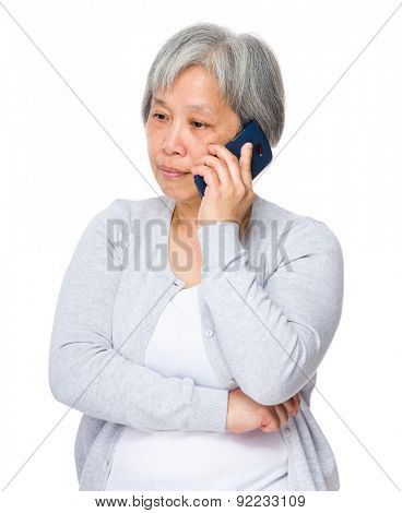 Mature woman talk to smart phone