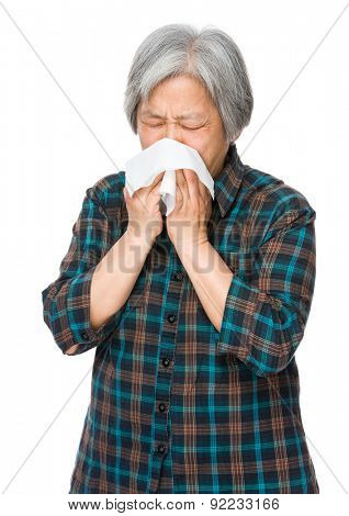 Elderly woman sneeze