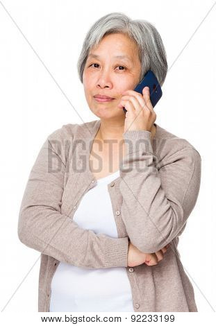 Chinese old woman talk to cellphone