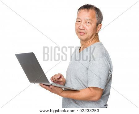 Mature man use of notebook computer