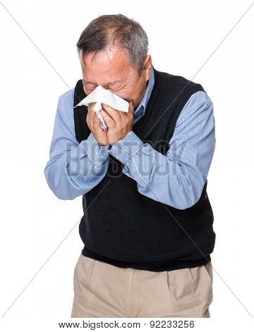 Mature man sneeze