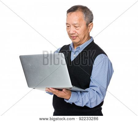 Asian mature man use of notebook computer