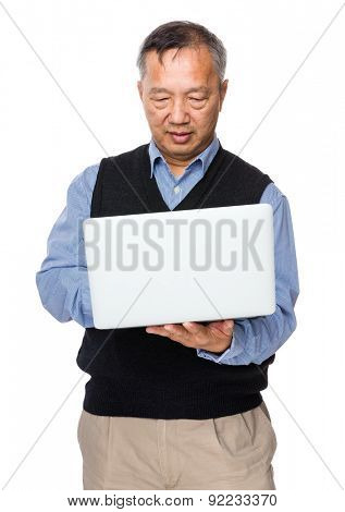Asian old man use of laptop computer
