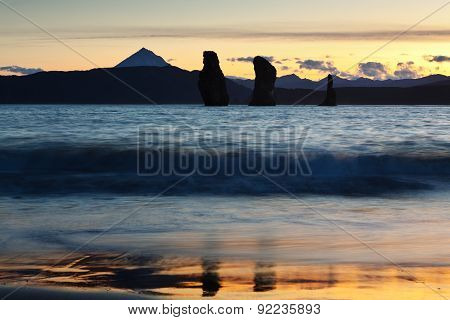 Three Brothers Rocks In Avachinskaya Bay At Sunset. Russia, Far East, Kamchatka