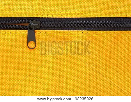 Zipper On Yellow Bag Background