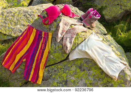 Ladies clothes on rocks closeup