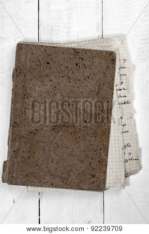 Old Notebook On A Wooden Desk
