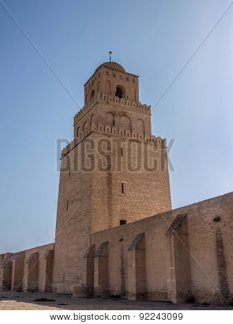 Tower Of The Great Mosque In Kairouan Against A Blue Sky