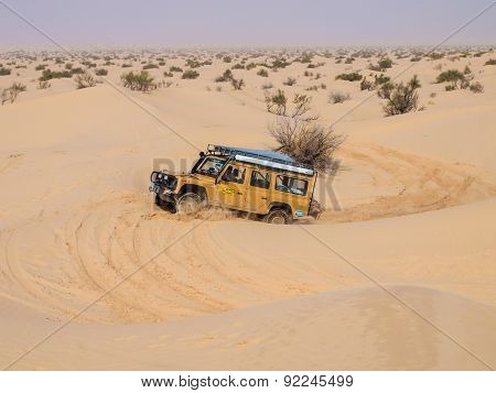 4X4 Vehicle Drives Around The Sand Dunes Of The Sahara Desert.