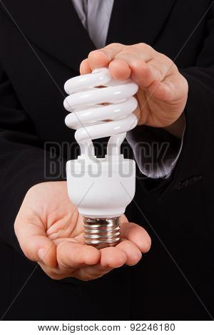 Business Woman Holds Economical Lightbulb