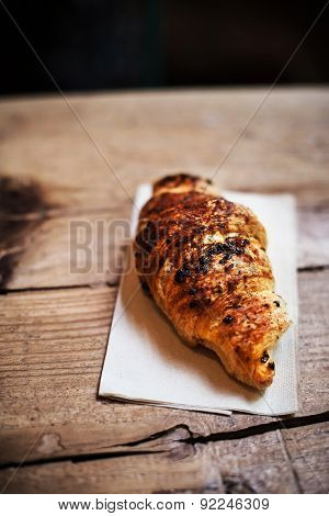 Fresh And Tasty Croissant Over Wooden Background For Breakfast. Chocolate Croissant Close Up With Co