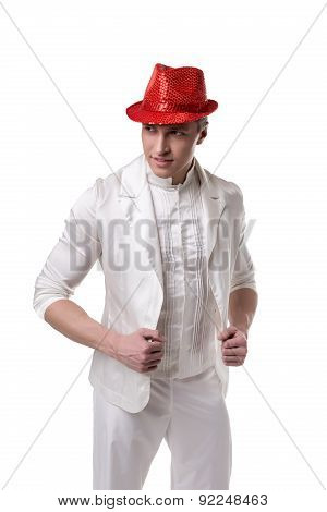 Elegant man dressed in white suit and shiny hat
