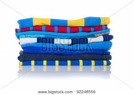 Neatly Folded Colourful Summer Shirts On A White Background