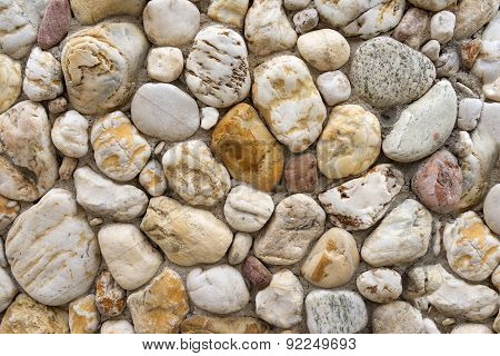 Pebble stones in a bright stone wall