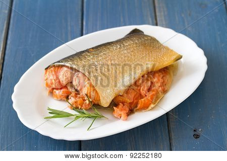 Smoked Salmon On Dish On Blue Wooden Background