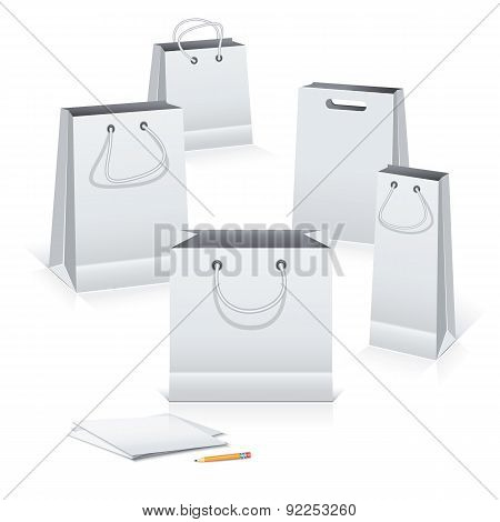 Bags, Pencil And Paper Sheets.