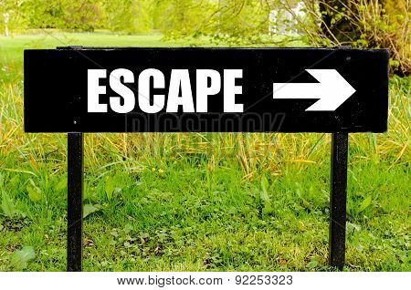 Escape Written On Directional Black Metal Sign