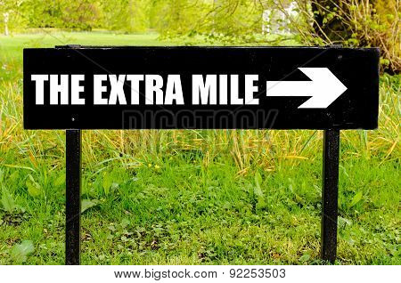 The Extra Mile Written On Directional Black Metal Sign