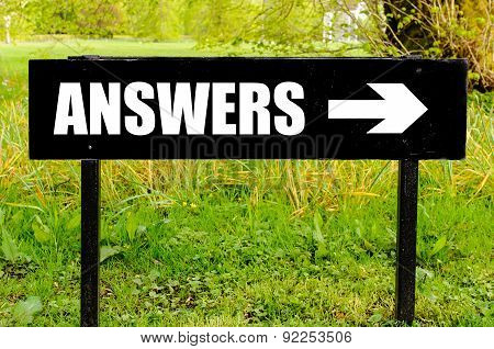 Answers Written On Directional Black Metal Sign
