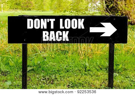 Do Not Look Back Written On Directional Black Metal Sign