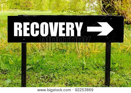 Recovery Written On Directional Black Metal Sign