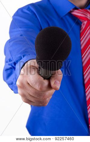 Businessman Reaching Microphone For Interview