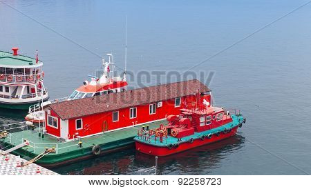 Red Fire Boat Stand Moored Near Floating Fire Station