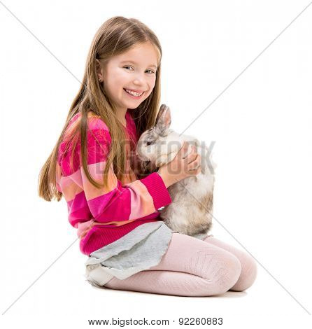 cute little girl in a crimson sweater  with baby rabbit over white