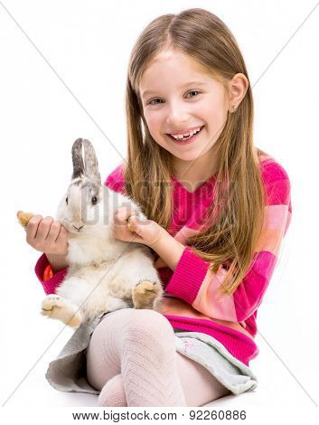 smiling girl in a crimson sweater  with baby rabbit isolated over white background close-up