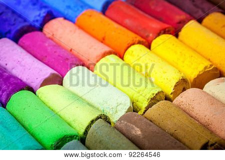 soft artist pastel crayons with vibrant blue, red, green, yellow colors - abstract