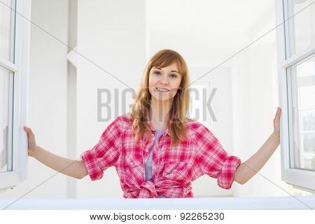 Smiling woman looking through window