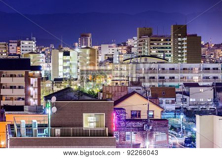 Kyoto, Japan night cityscape of residential high rises.