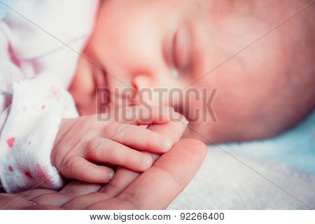 Hand The Sleeping Baby Girl In The Palm Of Mother