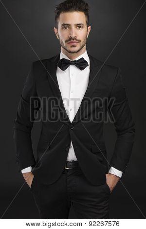 Portrait of a beautiful latin man wearing a tuxedo