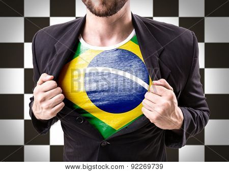 Businessman stretching suit with Brazil flag on checkered background
