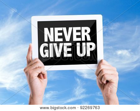 Tablet pc with text Never Give Up with sky background