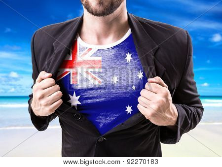 Businessman stretching suit with Australia Flag on beach background
