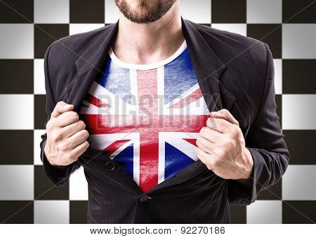 Businessman stretching suit with United Kingdom Flag on checkered background