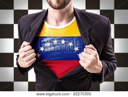 Businessman stretching suit with Venezuela flag on checkered background