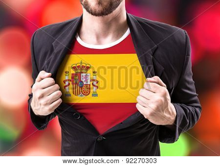 Businessman stretching suit with Spain flag on bokeh background