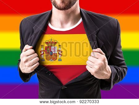Businessman stretching suit with Spain flag with rainbow flag