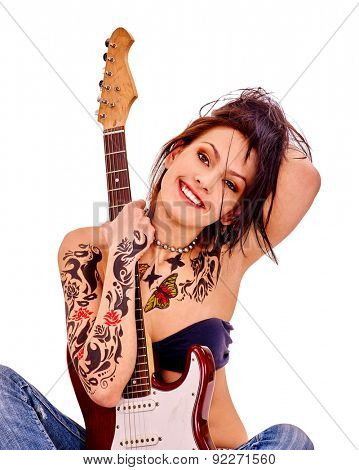 Young woman with long hair tattoo playing guitar on isolated.