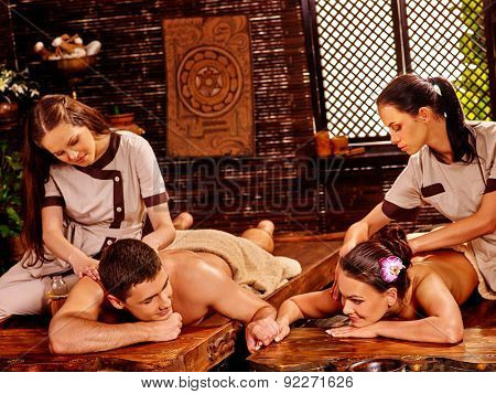 Couple  having oil Ayurveda spa treatment on open window background.