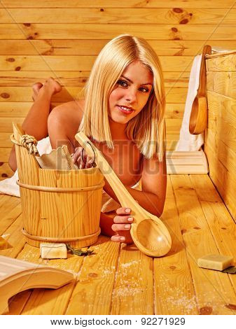 Young blond woman liying in sauna. Healthy lifestyle.