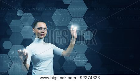 Young woman wearing headphones on digital background touching media screen