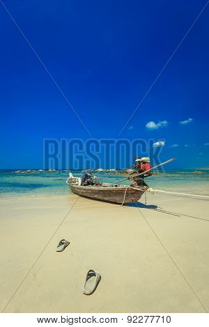 Traditional Thai Long Tail Boat On The Beach In Thailand