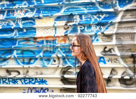 Portrait Of Beautiful Girl On The Colorful Wall Background