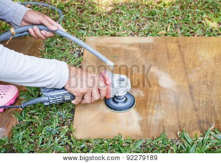 Worker Using Angle Grinder To Grinding On Sandstone