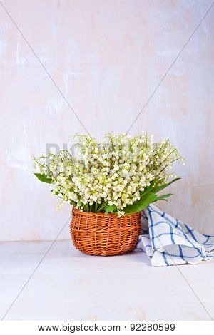 Lily of the valley on white wooden background