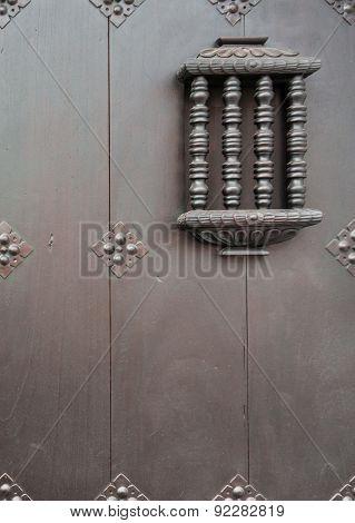 detail of security window in interesting door